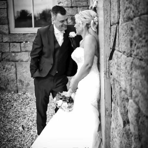 Derby Wedding Photographer - Tiara Package - Bride and Groom leaning against a wall.