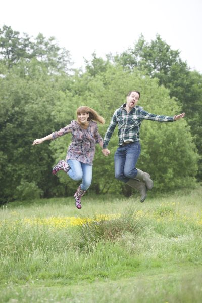Young Couple Jumping Green Screen Fun portrait by AF1 the derby family portrait photographer