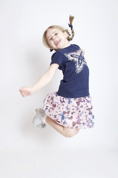 Young girl jumping fun portrait by the family portrait photographer in Derby - AF1
